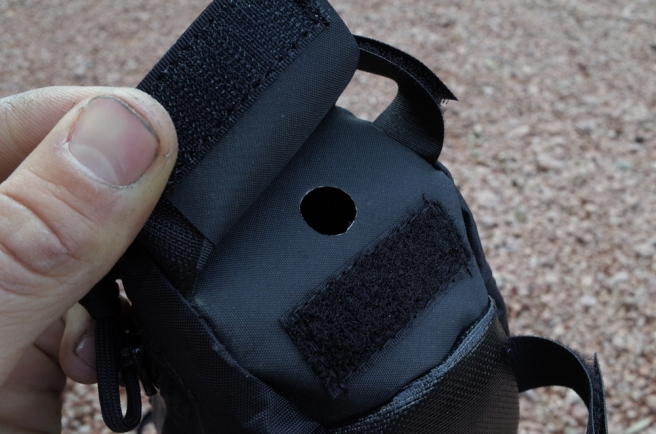 This is a hydration port on one of the framebags. I use Hypalon fabric, because it frays very little and can be easily cut by the end user. So the port starts as a hole the width of a hydration tube, and the user can widen it to fit a bite valve, if desired.